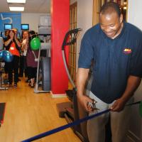 im Witherspoon cuts the ribbon at Y+ Fitness Surbiton