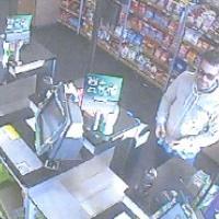 Man at shop counter